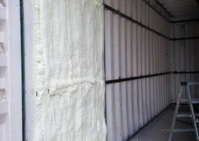 Polyurethane sprayfoam on container surface